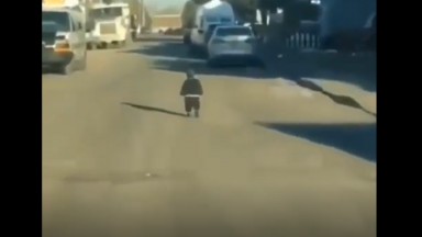 Holding Him Like A AK: Dude Finds Baby Running Around In The Middle Of The Street!