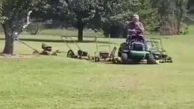 This guy has rigged up a whole army of mowers to keep his lawn looking great