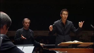 World famous conductor shows student how to really take command of an orchestra